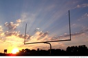 Sunset #4 -- This is the shot. It's not your standard sunset shot. I am not a sports photographer by any means, but the addition of the goal post, which both lends a human element and draws us into the picture (it also draws our eyes upward), makes this an effective photograph.